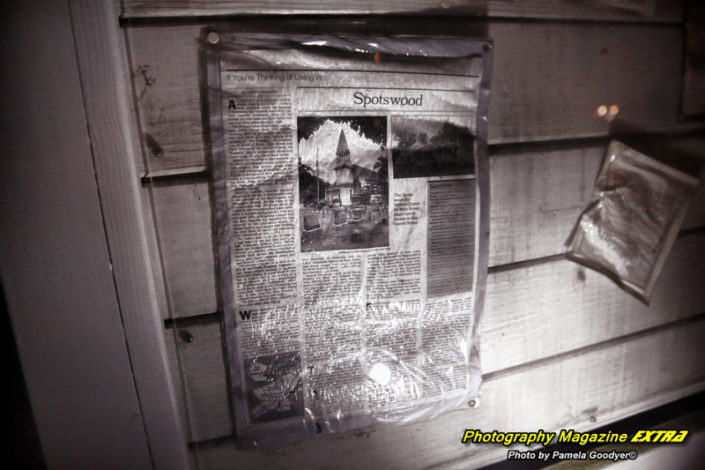 Very scary looking newspaper article light up with a flashlight during ghost hunting