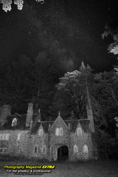 Very dark castle with the milky way above it in the dark