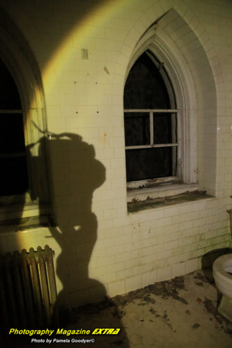 Ghost hunting in new york state, catskills showing a shadow of a camera very large on the castle wall.