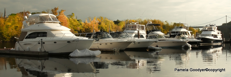 Boats in th water with fall foliage background
