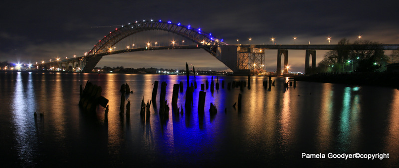Bayonne Bridge at night time with reflections on colored waters Pamela Goodyer Fine Art Photography Magazine Extra