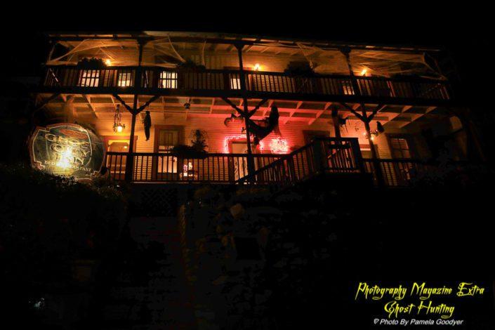 Night time very creepy image of the Ghost City Inn, Jerome Arizona