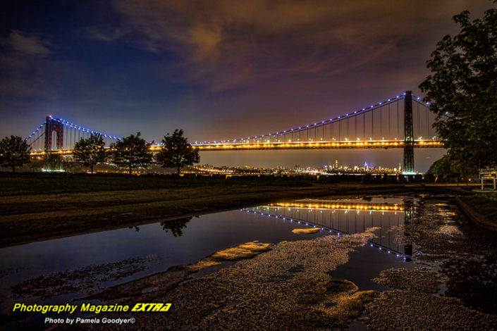 George Washington Bridge, New Jersey, night skies with the lights light in a long exposure reflecting in a puddle