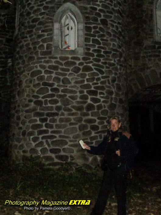 World Renowned Photographer Pamela Goodyer, Catskill mountains, ny milky castle in the wilderness with world famous photographer and medium Pamela Goodyer holding camera and ghost detector