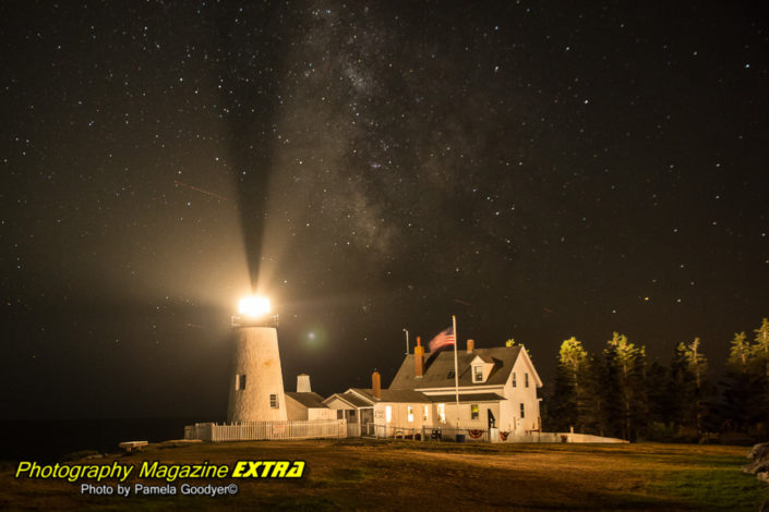 Pemaquid Point lighthouse at night with the milky way in the background with lights shining up to the milky way.