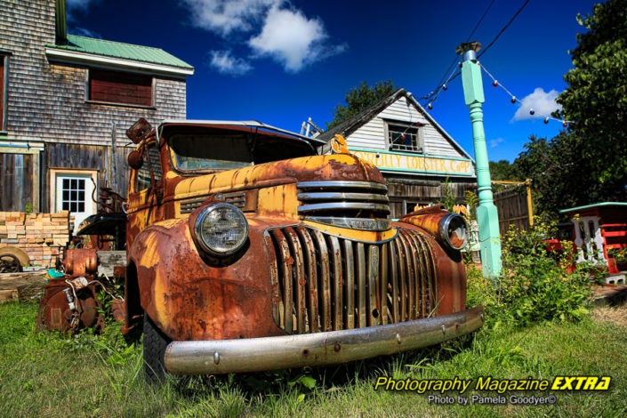 cape porpoise maine old tow truck with colorful blue skies and Lobster Co-op.